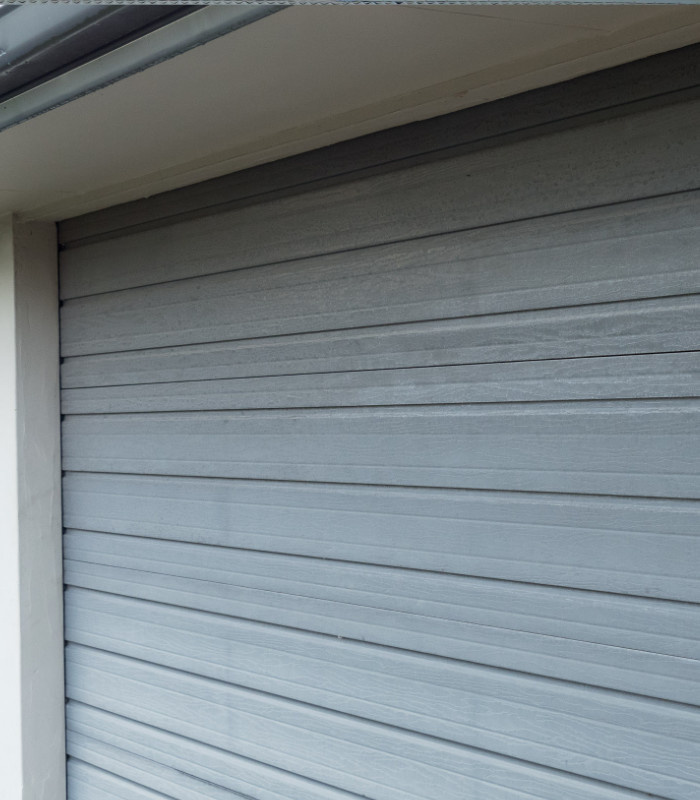 Side view of garage door before cleaning for restoration coating