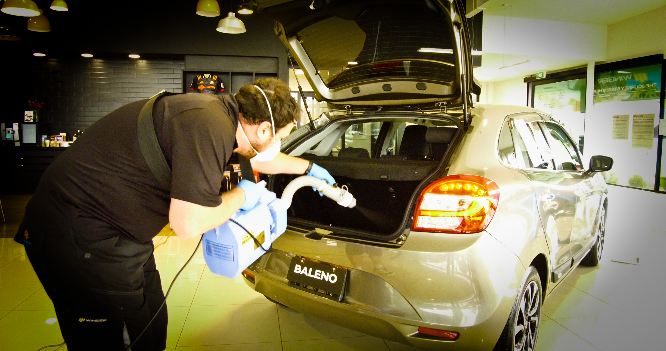 Applying product to rear boot hatch area and sanitising
